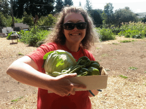 BEST Founder, Penny Condoll, enjoys the garden bounty at Victory Farms!